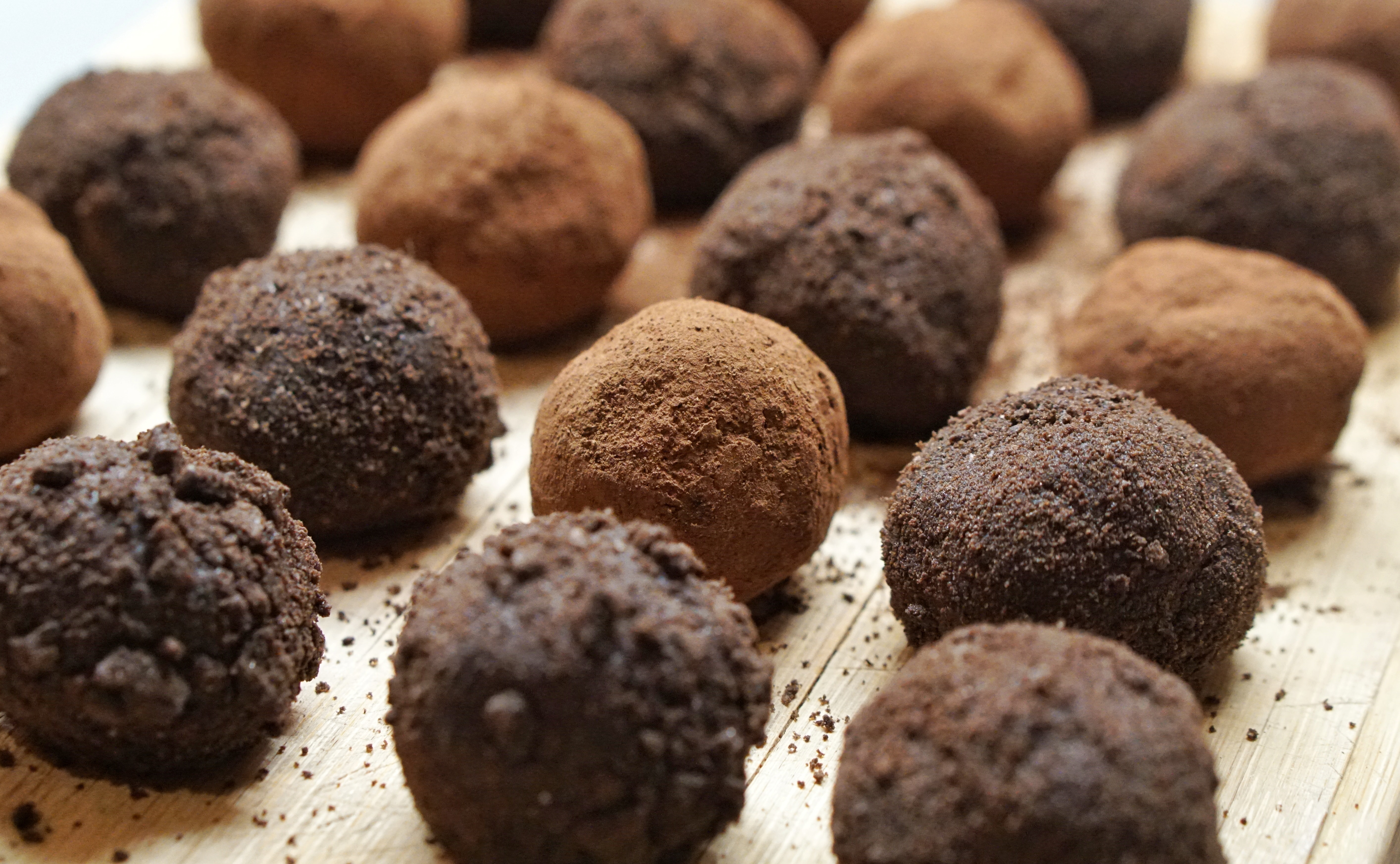 Rows of Chocolate Truffles in Against a White Background