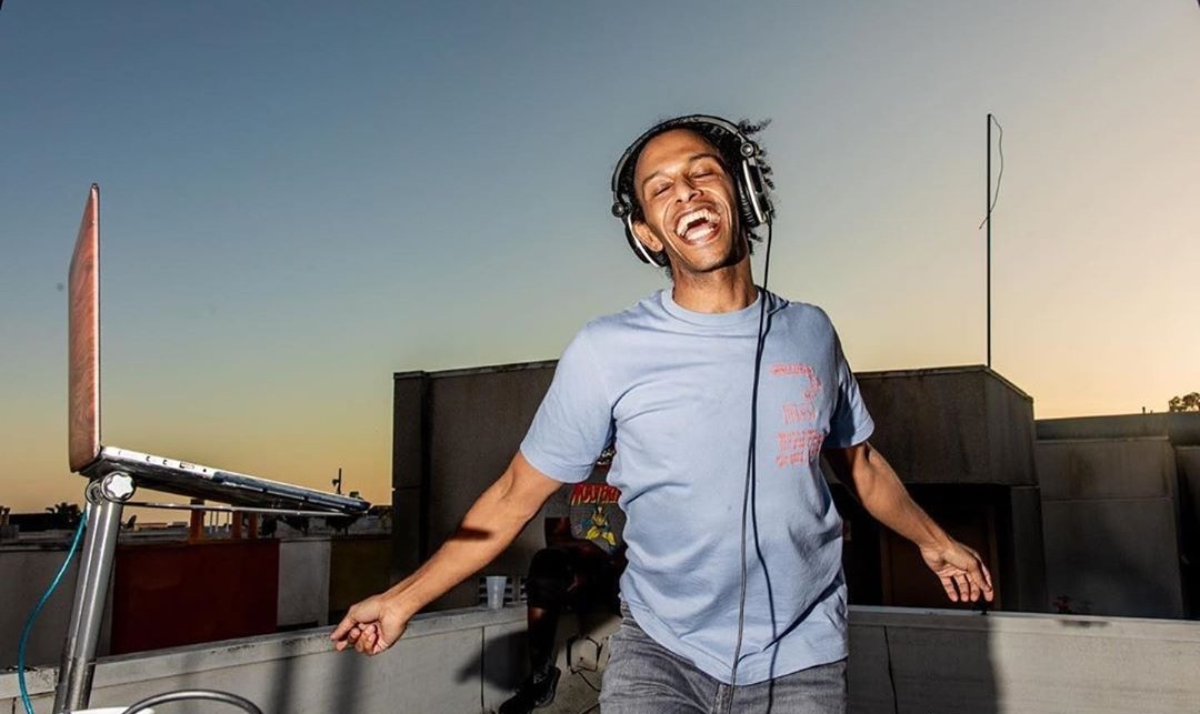 DJ Shammy Dee poses on a rooftop