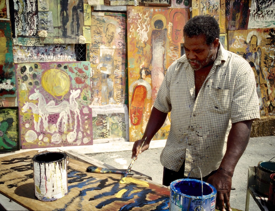 purvis young paints in an outdoor studio space