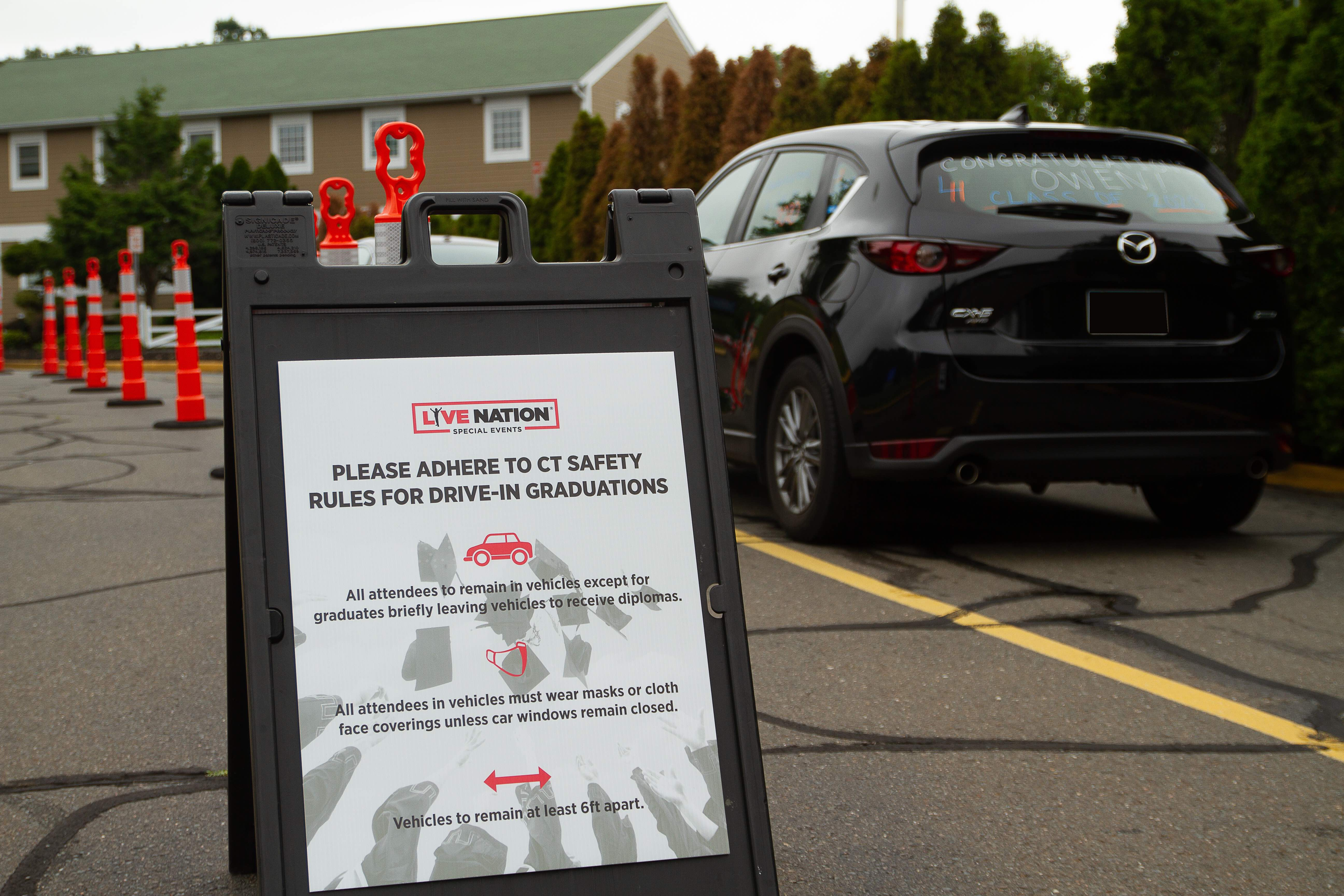 Sandwich board displaying safety guidelines in the Toyota Presents Oakdale Theatre lot