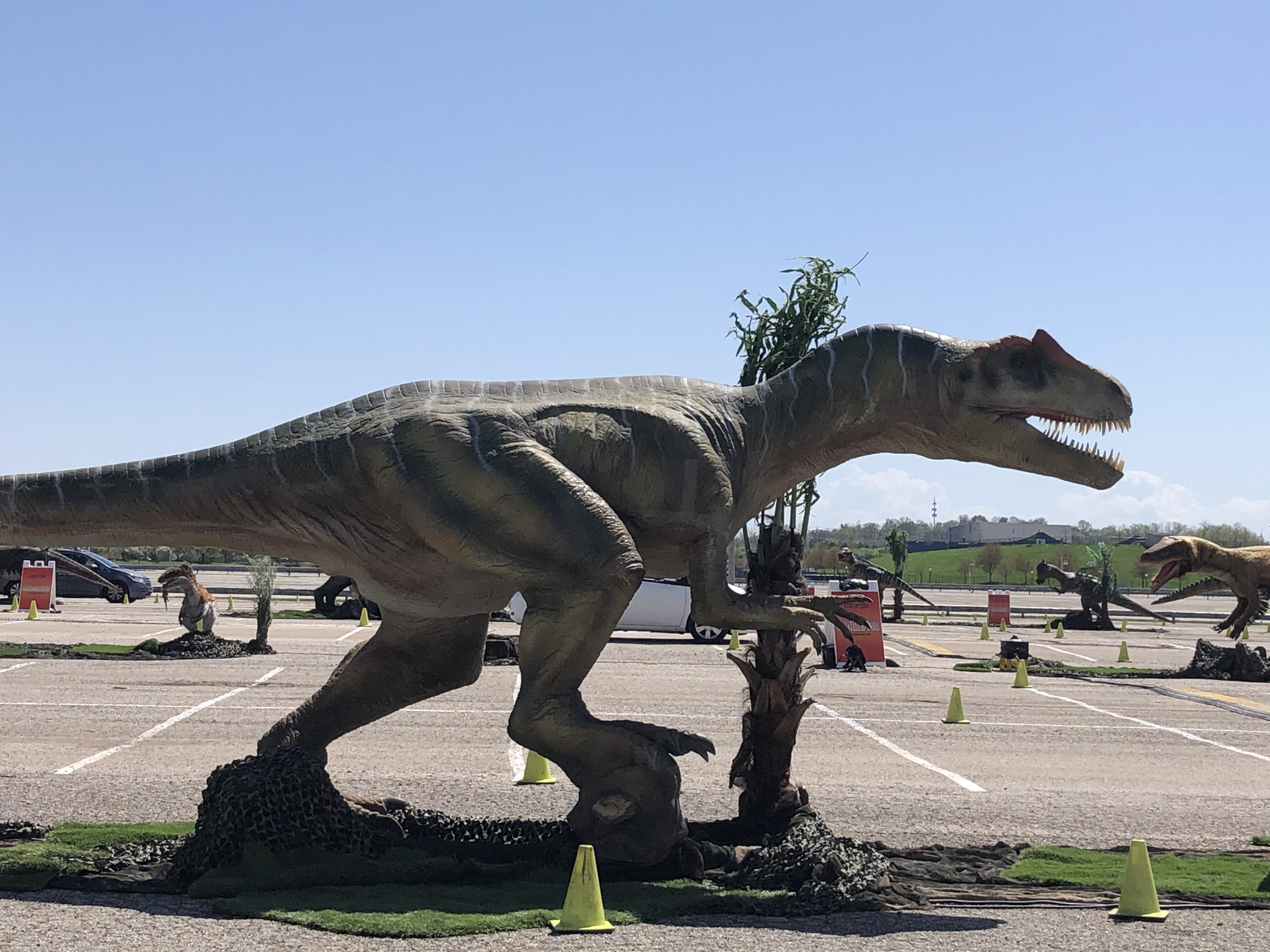 dinosaur statue in parking lot of hollywood casino amphitheater
