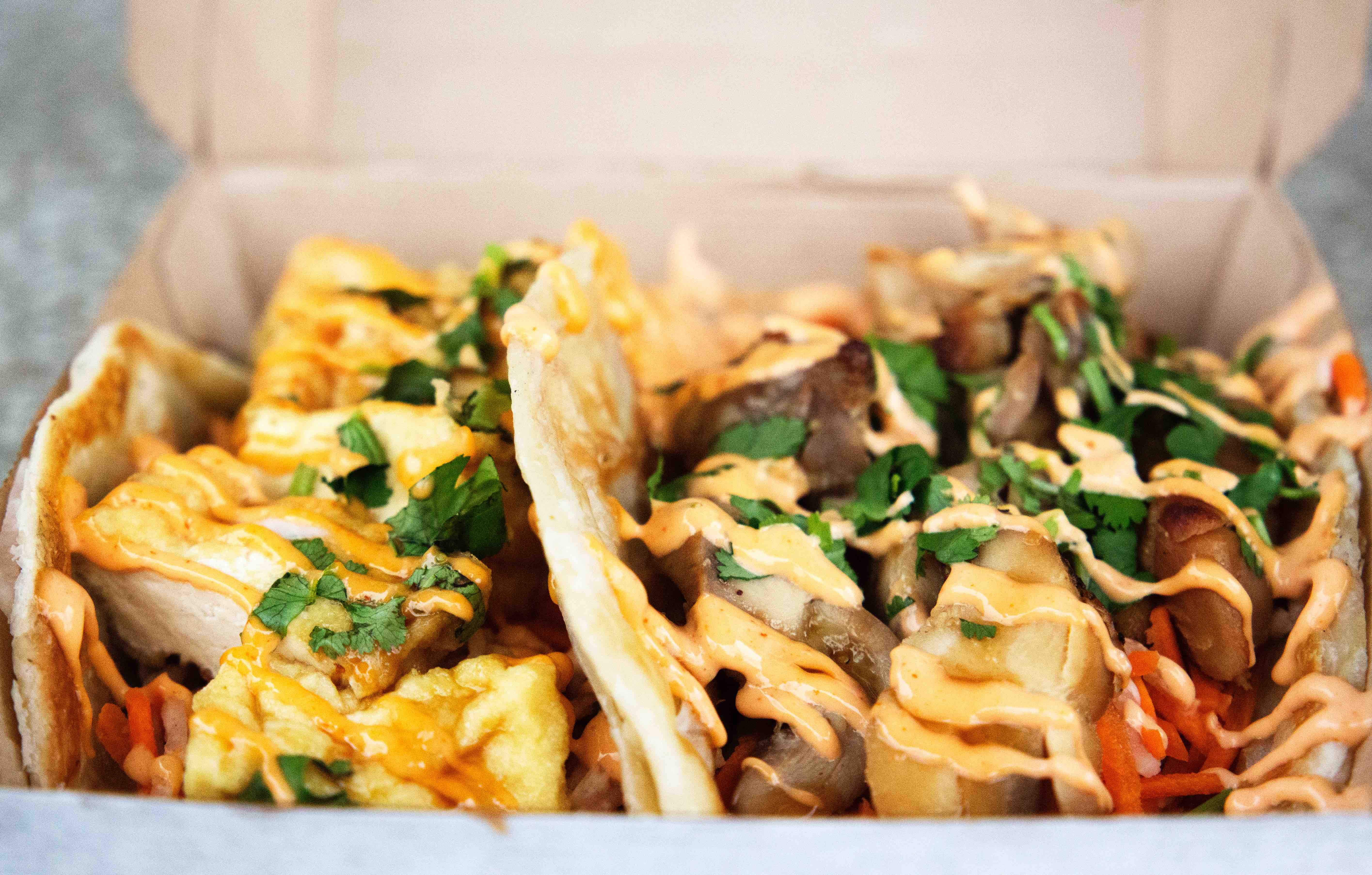 tacos in food truck-style paper tray